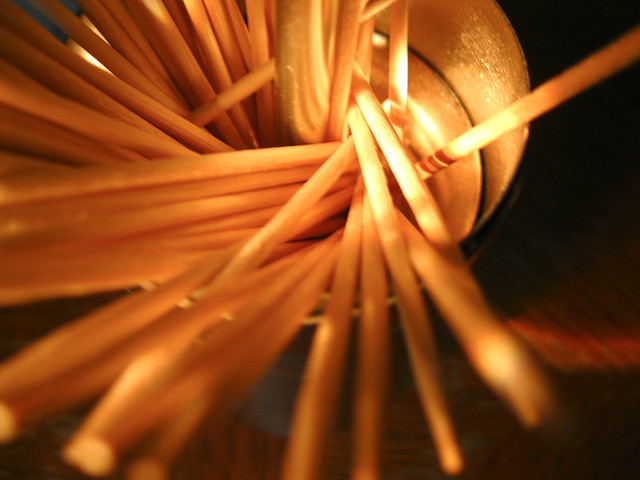 toothpicks illuminated by flashlight