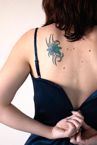 Beautiful Flower Tattoo on Upper back Girl