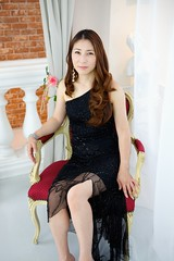 Japanese woman wearing black dress sitting in ...