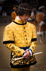 Palio di Siena, Toscany, Italy. One of the charachers of the parade caught in an intimate moment (Nicola Zingarelli) Tags: old costumes summer horses people italy travelling classic tourism colors race start square dangerous italian support colorful colours torre flag awesome traditional crowd hard fast competition august run tourist flags parade traveller tuscany winner historical brave siena tradition crush lupa palio holydays multitude supporters touristattractions giraffa fearless oca piazzadelcampo mossa tuscan turism onda holyday palazzocomunale toscany compete contrada civetta jokeys tartuca nicchio paliodisiena touristdestination istrice touristdestinations holydais paliodellassunta liocorno colorfulcontrast flagsexhibition flagsgames middleageparade monumentalsquarebeautiful