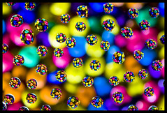 Candy Reflections (gogo159) Tags: pink blue orange color colour green geometric water yellow reflections droplets rainbow candy spectrum chocolate circles vivid refraction sweets getty mm candies gettyimages eyecatching