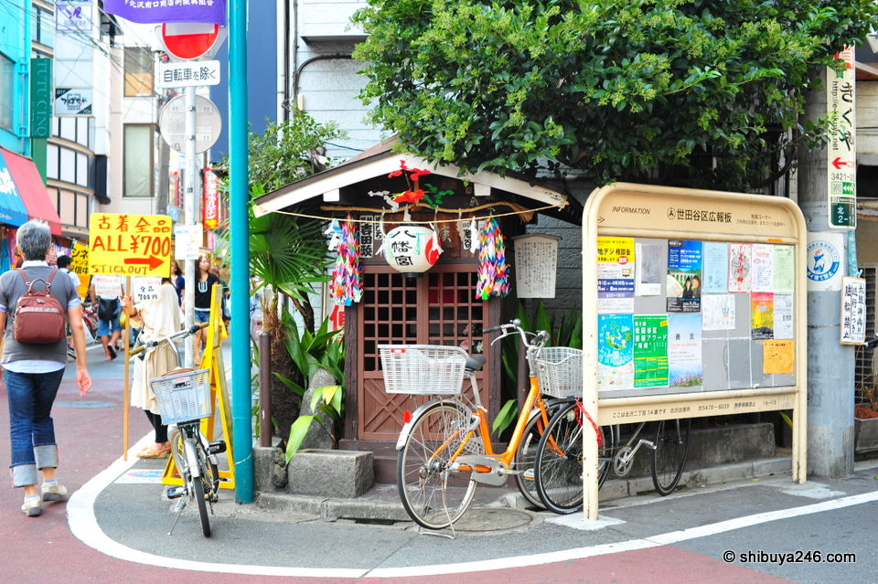 Small shrine in the busy street area