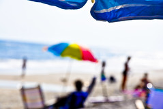 OnTheEdgeOfADream (wesbs) Tags: ocean people sunlight blur beach umbrella nikon bokeh dream beachumbrella hbw wesbs