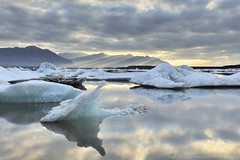 Dancing with Angels - Jokulsarlon, Iceland (cedric_g) Tags: reflection ice clouds sunrise landscape dawn iceland lagoon explore moutain icebergs jokulsarlon lightrays jkulsrln lightbeam nikond3x visipix cedricguilleminotphotography