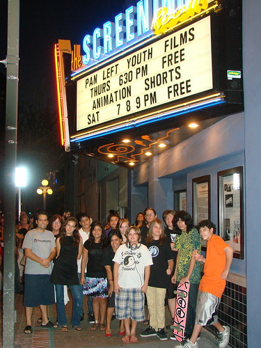 Youth and teachers at screening room