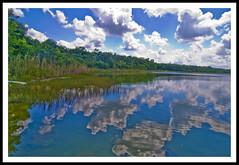punta laguna (prex79) Tags: sky reflection clouds photoshop canon mexico nuvole tokina cielo saturation punta 12mm laguna 1224 2010 messico quintanaroo riflesso puntalaguna eos400d
