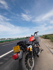 Heed the call (mysaliva) Tags: blue sky bike clouds highway tour empty olympus harleydavidson motorcycle ep2 883r northeastchina jilinprovince