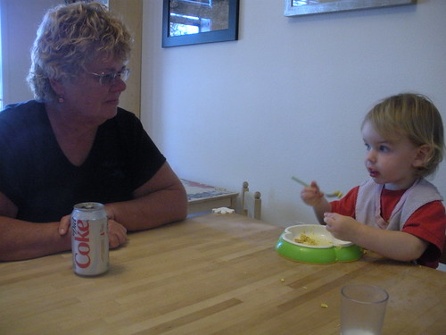 Aunt Peg is impressed with how well Sam manages a fork and spoon