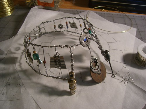 Collar made from stainless steel wire, glass beads, and found objects
