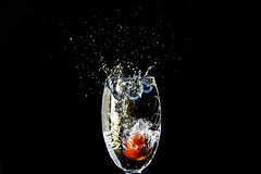 The tomato that made a mess (Danny Beattie) Tags: wet water glass tomato ripple drop explore splash frontpage waterdroplets sinking strobist sonya550