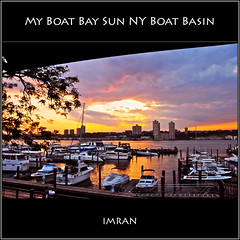 My Boat, Bay, Sun, NY Boat Basin - IMRAN  2350+ Views! (ImranAnwar) Tags: ocean newyorkcity travel trees red summer sky stilllife newyork reflection beach water silhouette yellow architecture clouds square outdoors landscapes nikon marine seasons dusk manhattan framed landmarks peaceful tranquility boating imran 2010 yachting lifestyles d300 motorboating imrananwar
