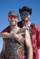I think this couple and I were accidentally stalking each other (Chicago_Tim) Tags: city man black art festival rock couple nevada burningman blackrockcity burning metropolis shawn ralph 2010