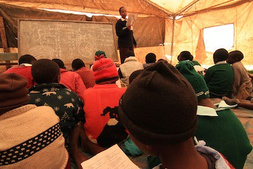 Teaching primary class on mats, Solio Settlement Village 2, Central Kenya