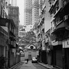 Le silence éternel de ces espaces infinis m'effraie ((stephenleopold)) Tags: buildings hongkong voiture 香港 ilforddelta400 clim homme lampadaire manmotemple sheungwan squarestreet zeissikontaxona virela10 gardela9