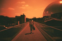 2010-0624-1417 (t-a-i) Tags: bridge shadow red sky people sun man paris france june museum ball walking iso100 mirror lomo lca lomography europe lomolca mirrorball sciencemuseum parcdelavillette metalball 19tharrondisement redscale lomographyredscale100 citedessciencesetdelindustrie