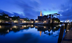 Maassluis @ Blue Hour (DolliaSH) Tags: city longexposure trip travel blue light vacation sky urban holiday haven holland color reflection tourism water colors architecture night clouds canon reflections photography lights noche photo topf50 europe blauw foto tour place nightshot photos nacht harbour nederland thenetherlands wideangle visit location tourist le journey destination bluehour traveling visiting topf150 topf100 1020 ultrawide nuit 1022mm notte touring stad maassluis 1022 noch zuidholland canonefs1022mmf3545usm southholland 50d supershot nachtopname canoneos50d anawesomeshot dollia dollias sheombar dolliash mygearandme