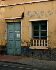 sobre la crisis y la decadencia ... del CAPITAL (mariano snchez g. del moral) Tags: azul ventana puerta nikon d70 colores alicante amarillo urbana crisis ocre 2010 abandonado decadente emeche