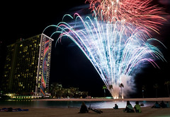 Bang (dc.roake) Tags: longexposure beach night hawaii oahu fireworks hilton lagoon honolulu friday hiltonhawaiianvillage rainbowtower shootingatnight dcroake