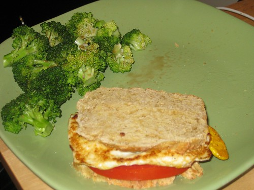 Fried egg sandwich and broccoli