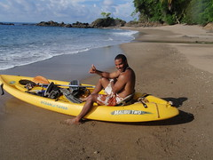 Sprout and kayak on Isla del Cano beach