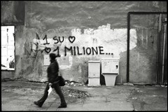 Uno Su Uno Milione ... (colster.) Tags: street urban bw italy white black film wall analog walking person photo paint grafitti aosta oneinamillion stride analague colster unomilione