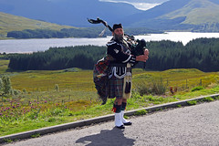 The Lone Piper (Ian Lambert) Tags: mountains scotland kilt thistle scottish tourist glencoe piper bagpipes bagpiper fortwilliam tartan scotsman rannochmoor lochtulla a82 scottishicons