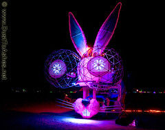 Burning Man 2010 Pink Bunny Art Car BM 2010 burningman (Dust To Ashes) Tags: burningmanfestival burningman2010 burningman metropolis theme burning man by bm2010 bm10 10 2010 bm dust ashes ash dusttoashes wwwdusttoashesnet sculpture sculptures installation installations surreal duststorm playa desert nevada alesprikryl gerlach nv blackrockcity brc bruno reno art burningmanart party desertparty people photography photos photo picture pictures ales summerfestival summervacation desertlandscapape pink bunny car night department mutant vehicles dmv artcar mobile projecting eyes
