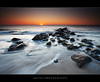 Surprise no HDR! :) :: 0.9H + 0.6H GND Lee Filters (:: Artie | Photography :: Travel ~ Oct) Tags: sunset sea seascape motion beach water photoshop canon landscapes movement sand rocks ripple tripod hard wave australia wideangle explore filter 09 lee adelaide filters southaustralia glenelg frontpage ef 1740mm artie cs3 f4l gnd nohdr lee09gnd leefilter 09h 5dmarkii 5dm2