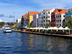 Willemstadt, Curacao - Colorful Array of Buildings (Ronnie Wiggin) Tags: cruise vacation sky holiday tourism colors architecture sailboat buildings reflections landscape photography harbor photo colorful ship searchthebest photos tourists curacao getty caribbean insidepassage waterway gettyimages vacationers willemstadt queenannebridge willemstadcuracaoisland