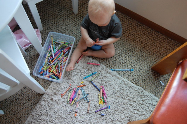 sneaking his sister's crayons