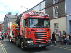 Carnival truck. (Bennydorm) Tags: urban town trucking commercialvehicle haulage julio luglio juli juillet inglaterra inghilterra rot rosso rouge fujifinepix europe uk gb britain england cumbria furness ulverston vehicle fun july street procession people parade carnival roadtransport road rig truck lorry scania hgv red