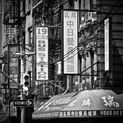 Chinatown (tim.perdue) Tags: chinatown nyc new york city big apple metropolis manhattan lower downtown signs one way arrow bus station pike st awning building fire escape square black white bw monochrome instagram chinese symbols
