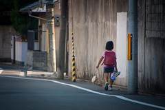 Japanese girl walking back home