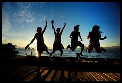 Jump! (Lefty Jor) Tags: girls shadow hk silhouette fun happy hongkong jump day crew 20mmf28 d700