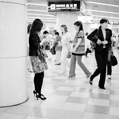 Umeda Underground (JanneM) Tags: bw woman 120 film station japan mediumformat phone pentax jan cellphone delta human 400   osaka mf kansai ilford 67 umeda janne   pentax67 moren janmoren