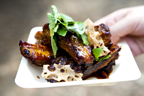 Plate of Honey Glazed Baby Back Ribs with Thai Basil & Mint with Lotus chips