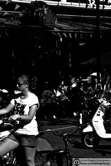 Summertime (Just a guy who likes to take pictures) Tags: street city summer portrait people urban bw en woman sun white black holland netherlands girl monochrome dutch sunglasses amsterdam bike wheel shirt female hair square t photography glasses und waiting europa europe long vespa pants legs candid sommer tail nederland thenetherlands bikes tshirt scooter jeans human zomer short wait holanda nl frau zwart wit weiss plein schwarz fahrrad vrouw metropol fietsen stad wachten fiets noordholland niederlande fahrrder zw warten the staart leidsche leidscheplein wacht staartje