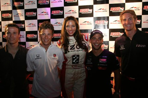The IZOD Trophy Girl poses with drivers
