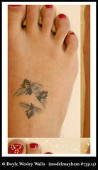 The Tattoo on Emma's Right Foot (Doyle Wesley Walls) Tags: 20166 foot toes tattoo ink toenails bees paintedtoes buzz sting tats feet photograph doylewesleywalls photo tat emma