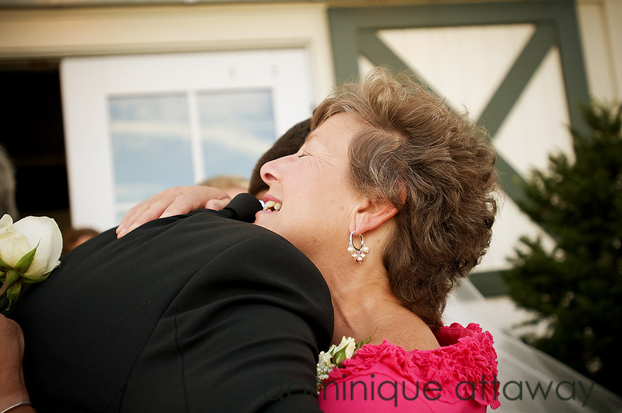 mother hugging groom