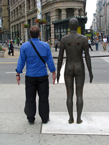 Clothed man with naked man