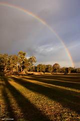 Rainbow and Shadows over Tallwoods (Black Diamond Images) Tags: sunset clouds rainbow shadows australia greatlakes nsw settingsun lateafternoonsun bdi hallidayspoint midnorthcoast manningvalley blackdiamondimages tallwoods tallwoodsgolfcourse arfternoonlight practicefairway hallidayspointtourism