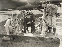 Avro Anson and airmen - planning their next mission, or possibly trainee navigators (whatsthatpicture) Tags: plane wwii aeroplane worldwarii airforce