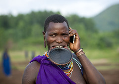 The beginning of the end? Surma woman with mobile phone - Ethiopia (Eric Lafforgue) Tags: portrait woman apple mobile tattoo mouth mac women call phone telephone culture progress tribal piercing appel tattoos clay mobilephone tribes bodymod tradition tribe tatoo calling ethnic surma scarification bodymodification femmes tribo telecom telecommunication labret tatuaje iphone 3702 ethnology tribu thiopien suri etiopia ethiopie progres etiopa telephoneportable  etiopija ethnie ethiopi  lipplug etiopien etipia  etiyopya       tulgit    turgit lipdisclipplate piercedhole piercedlipornament