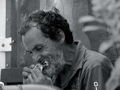 Hambre!/Hunger! (Joe Lomas) Tags: leica urban blackandwhite bw espaa byn blancoynegro spain candid reality streetphoto almeria cabodegata urbanphoto realidad callejero robados maneating realphoto fotourbana fotoenlacalle fotoreal photostakenwithaleica hombrecomiendo
