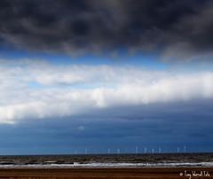 Stormy New Brighton (Tony Worrall) Tags: blue sea sky beach wet water weather clouds liverpool seaside rocks view northwest shoreline scenic rocky stormy windmills birkenhead strip shore mersey windfarm wallasey wirral newbrighton merseyside scouse cloudbank