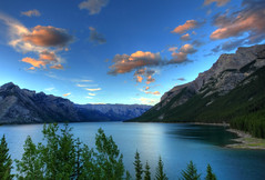 Lake Minnewanka (Jim Boud) Tags: travel blue sunset portrait sky mountain lake canada mountains reflection tree green nature pinetree clouds canon lens outdoors eos nationalpark still cloudy dusk hiking hill rocky peaceful wideangle calm alberta northamerica banff layers usm dslr digitalrebel photoart digitalslr pinetrees hdr highdynamicrange province merge blend artisticphotography superwideangle partlycloudy multipleexposures lakeminnewanka canadianrockies 10mm canonefs1022mm 550d jimboud t2i photomatixhdr watercape topazadjust jamesboud eos550d kissx4