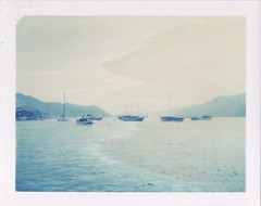 Where the boats go (emilie79*) Tags: blue sea turkey boats kekova polaroid180 iduvfilm