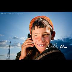 Salam Pakistan (khalilshah) Tags: road blue pakistan sky tower smile mobile clouds graphicart happy photography day phone cellphone cap independence