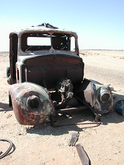 rusty car wreck on the William Ck Coober Pedy road. (spelio) Tags: rusty crusty outback sa south australia coober pedy road sand dune stuck old wreck travel 2009 favs favourites favorites vehicle fave